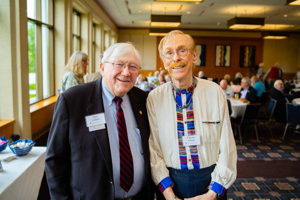President Emeritus Don Lubbers posing with a guest at the Retiree Reception.